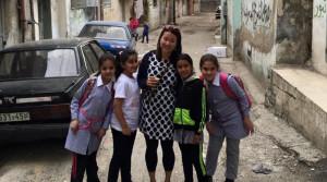 Ramallah Tour - a client with Palestinain children in al-Amari refugee camp.