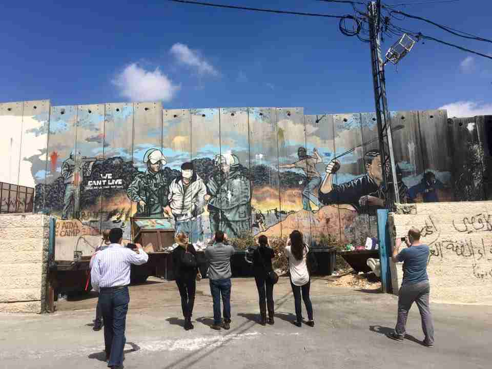 Bethlehem Tour - Graduate students from the University of Chicago visiting the Separation Barrier in the Aida refugee camp.